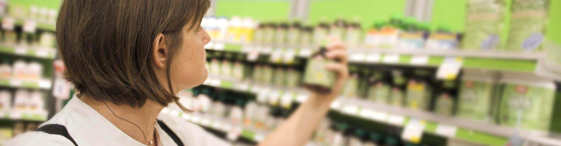 Woman shopping and looking at health products in drugstore